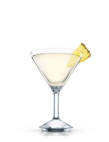 absolut peppar pineapple martini against white background