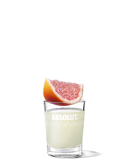 grapefruit drop shot against white background