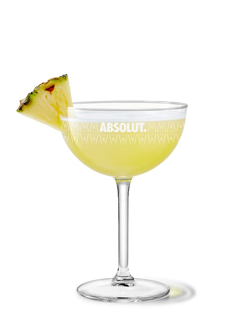 pineapple martini against white background