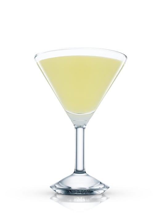 basil and pineapple martini against white background