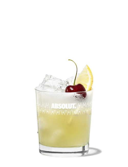 gin sour against white background
