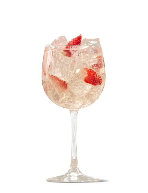 absolut juice strawberry and tonic against white background