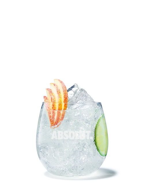 absolut apple soda against white background