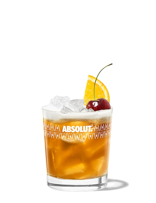 amaretto sour against white background