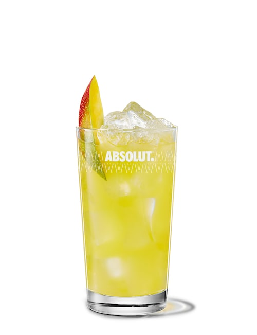 absolut mango with orange juice against white background