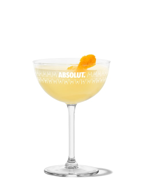 lemon drop martini against white background