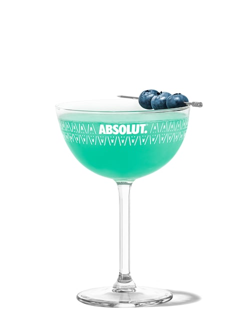 blue raspberry martini against white background