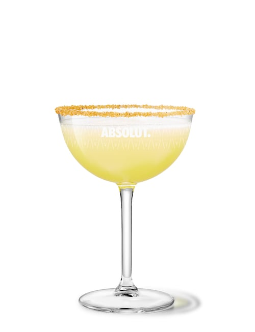 absolut spiced apple sour against white background