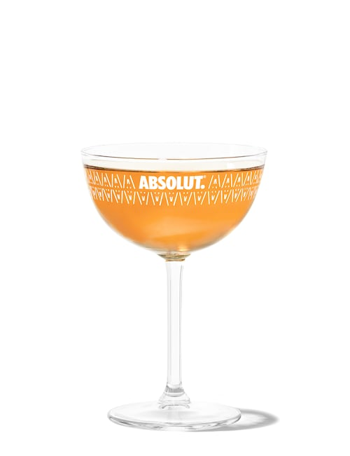 spooky pumpkin martini against white background