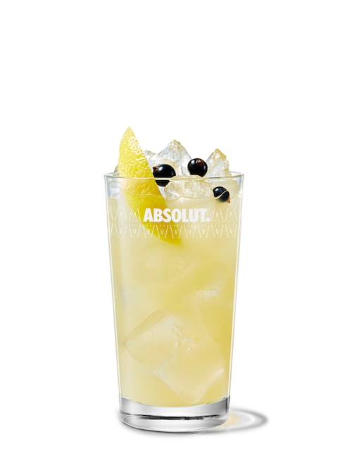 absolut kurant with apple juice against white background