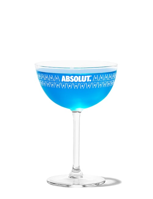 blue dolphin martini against white background