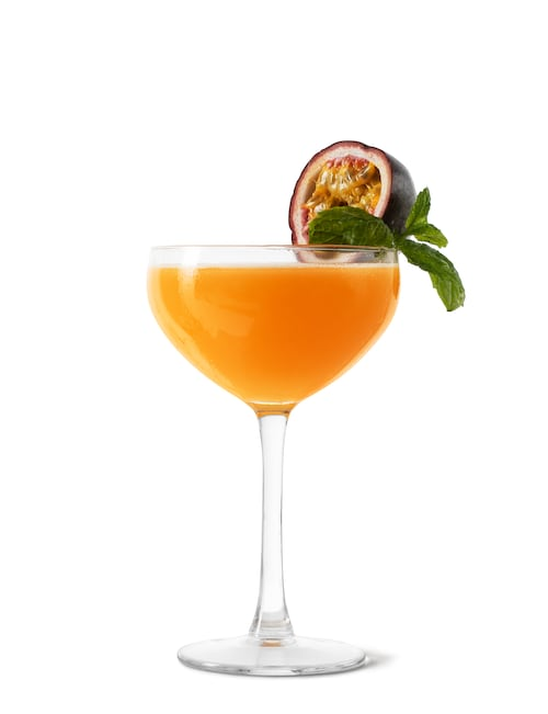 passionfruit & blood orange martini against white background