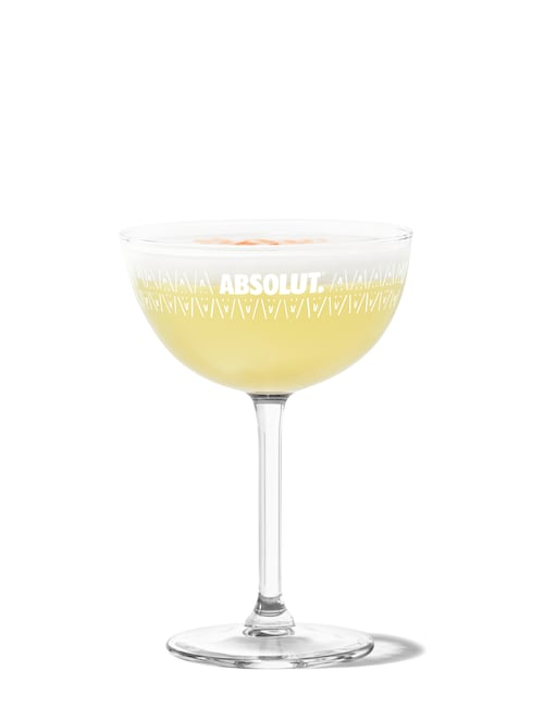 pisco sour against white background