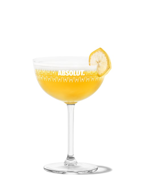 yellow bird martini against white background