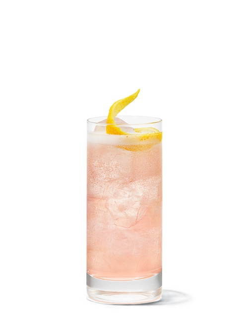 passionfruit collins against white background