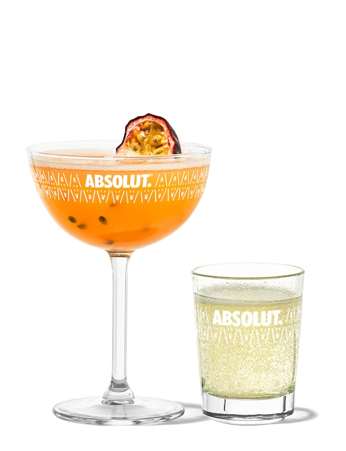 passion fruit martini against white background