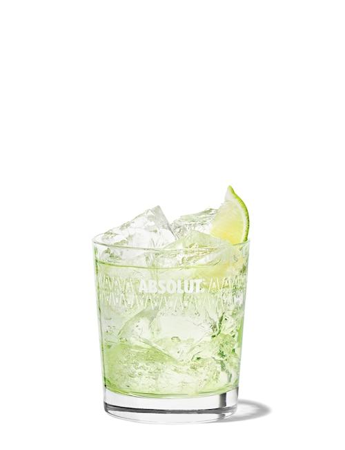absolut vodka gimlet against white background