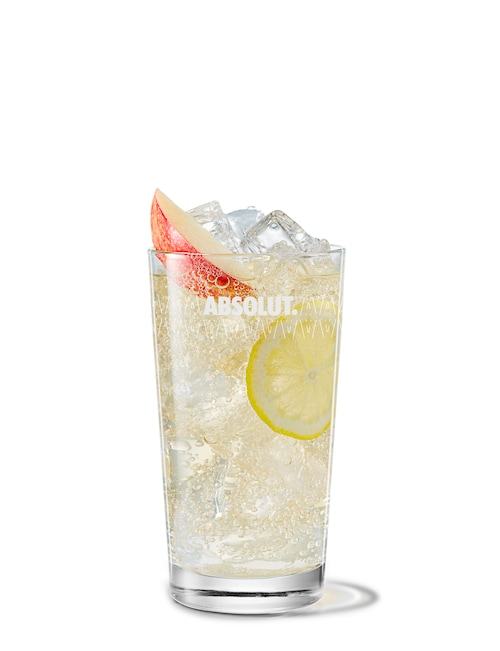 absolut äpple with ginger ale against white background