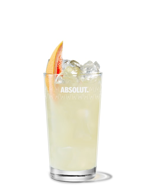 absolut ruby red with grapefruit juice against white background