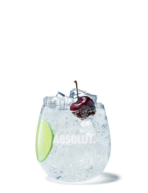 absolut cherrys soda against white background