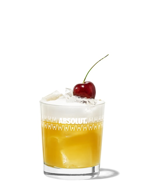 whiskey sour against white background