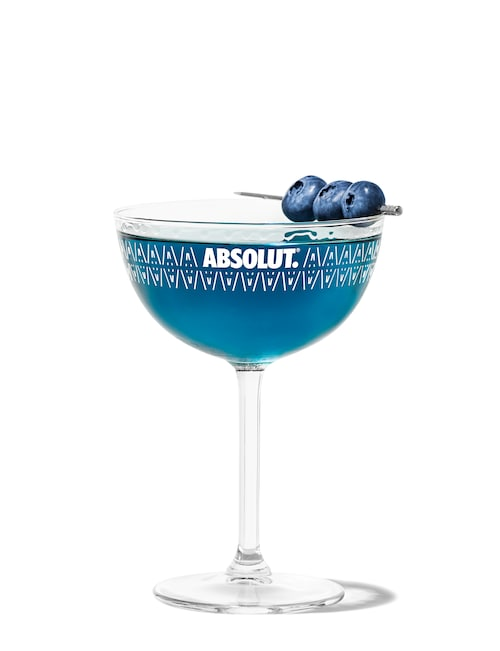 blueberry martini against white background