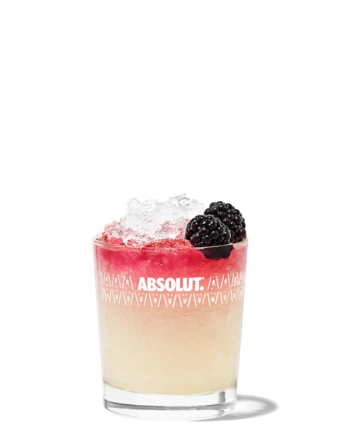 vodka bramble against white background