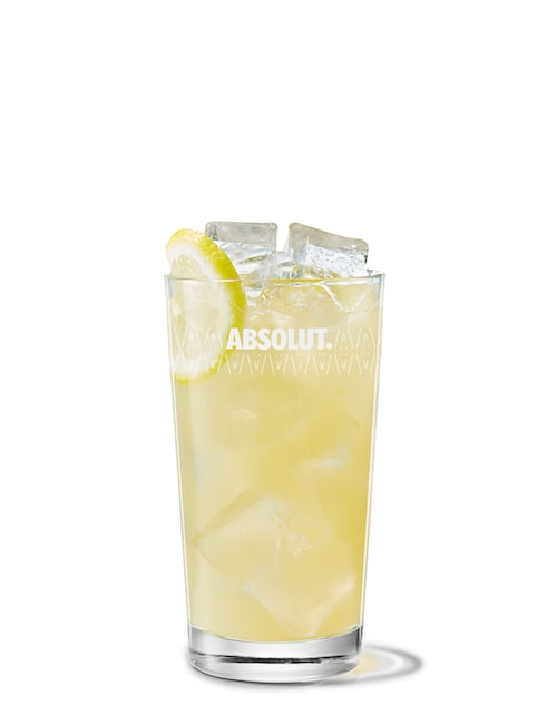 absolut vanilia with cloudy apple juice against white background