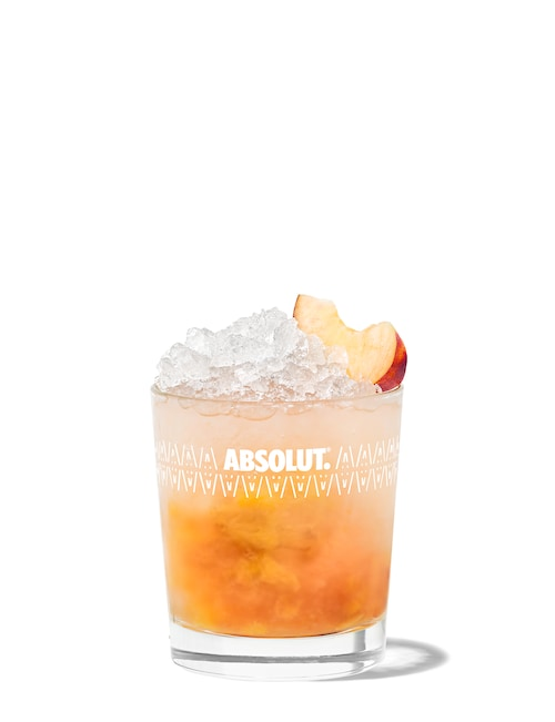 absolut peach crush against white background